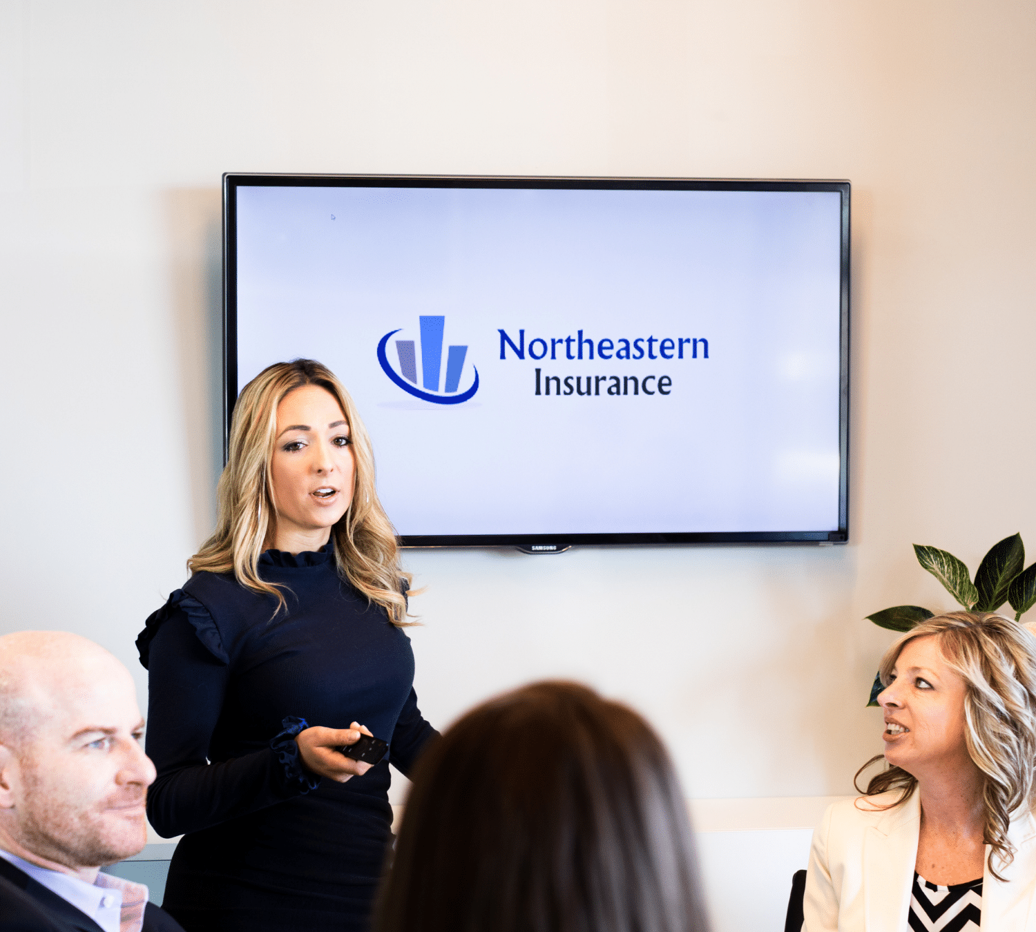 Women presenting at northeastern insurance
